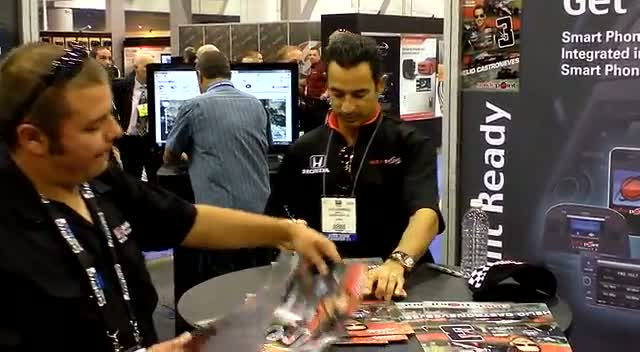 Helio Castroneves Meets And Greets Fans At SEMA