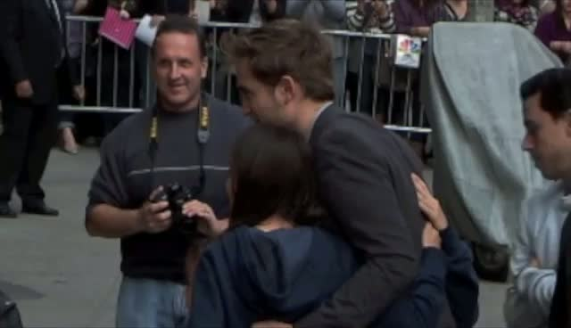 Robert Pattinson Takes Photos With Lucky Fans
