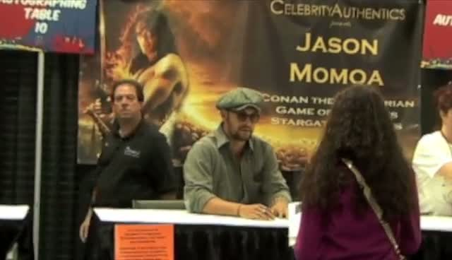 Jason Momoa Signs Poster For Lucky Fan