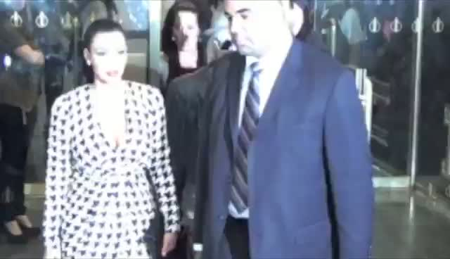 Kim Kardashian Signs Fan's Hand With Borrowed Pen