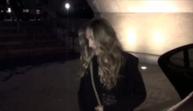 A Happy Sarah Jessica Parker Teases Photographers With Her Dress