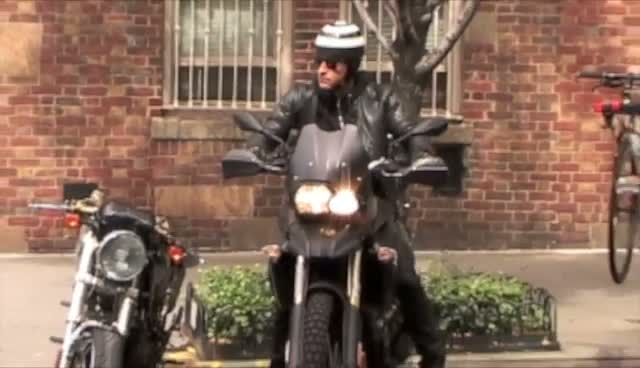 Loved-Up Justin Theroux Zooming About On His Motorbike