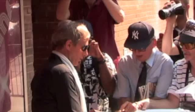 Michael Bolton Signing Autographs For Lucky Fans