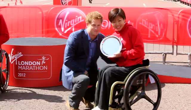 Prince Harry Presents Wheelchair Marathon Winners' Trophies In Front Of Palace