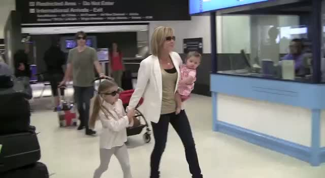 Amanda Holden Gets Escorted To A Car At Lax With Her Husband And Daughters