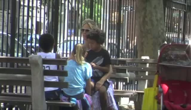 Heidi Klum Chats With Kids At Soho Park