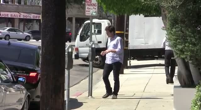 Jason Bateman Distracted By Parking Meter On The Way To Salon