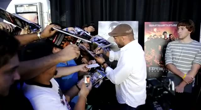 Randy Couture Autographs Fan Photos At Expendables 2 Premiere