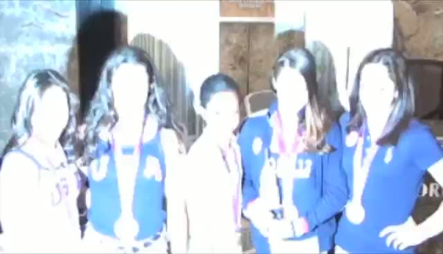 US Gymnastic Team The Fierce Five Show Off Gold Medals At Empire State Building Light-Up