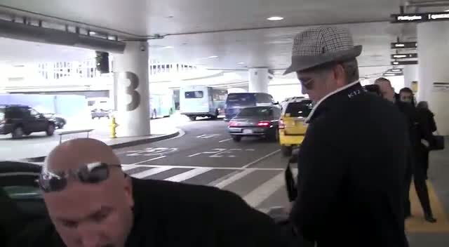 George Clooney Or Mel Gibson? The Paparazzi Get Muddled As Star Arrives At Airport
