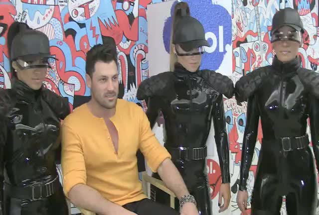 Maksim Chmerkovskiy Snapped With Latex Clad Dancers At AOL Event