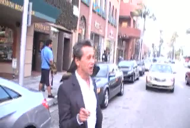 Brian Grazer Jaywalks To His Car