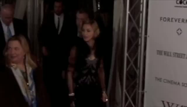 Madonna Wears Eye Catching Black Dress...