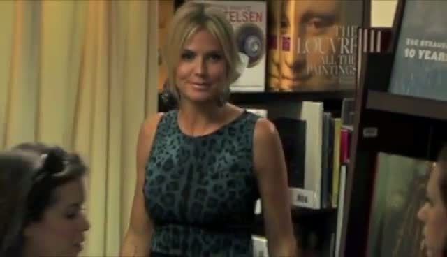 Heidi Klum Hides Behind 'Project Runway' Book At Signing