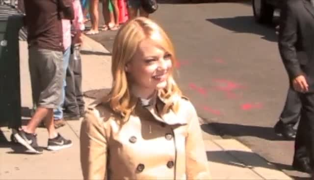 Emma Stone Arriving And Leaving 'David Letterman' In Nude Trench Coat