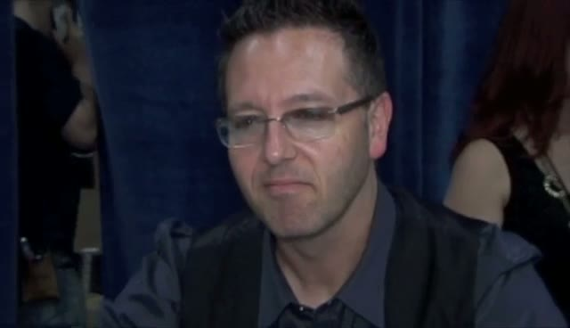 John Edward Poses With 'Fallen Masters' At New York Book Expo