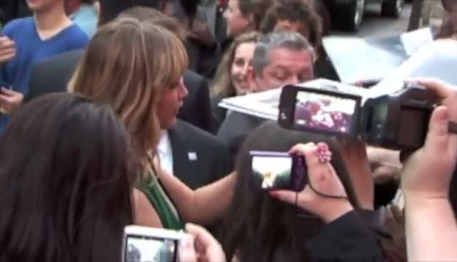 Jennifer Lawrence and Liam Hemsworth Interact With Fans At The Hunger Games New York Screening