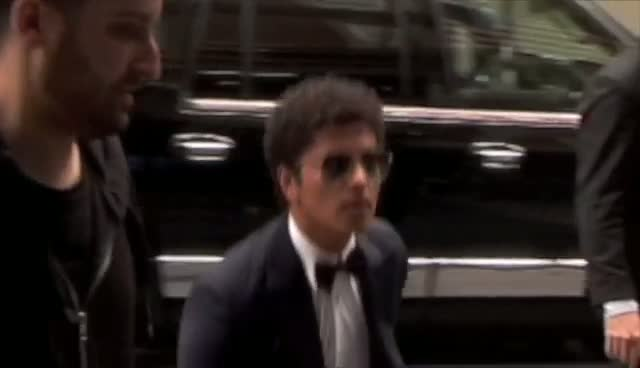Bruno Mars Waves Before Jumping Into Car Outside Hotel