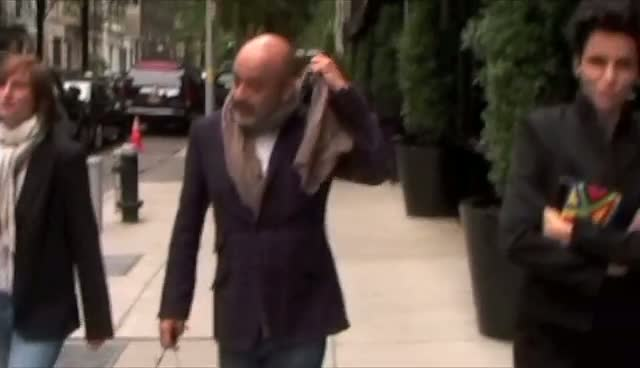 Foot Fashionista Christian Louboutin Leaves His Hotel