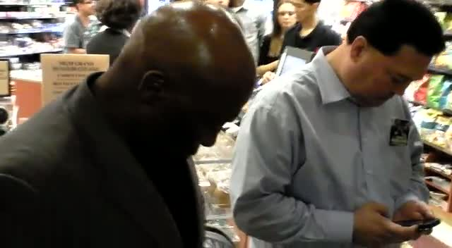 Earnie Shavers Signs Boxing Glove For Fan In Vegas