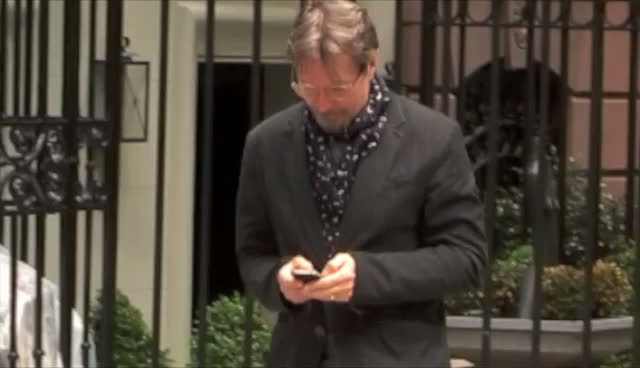 Gary Oldman Leaves His Hotel Texting