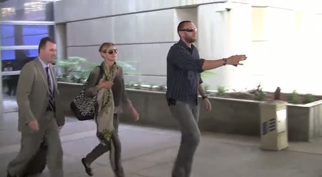 Heidi Klum Cheered By Children At LAX