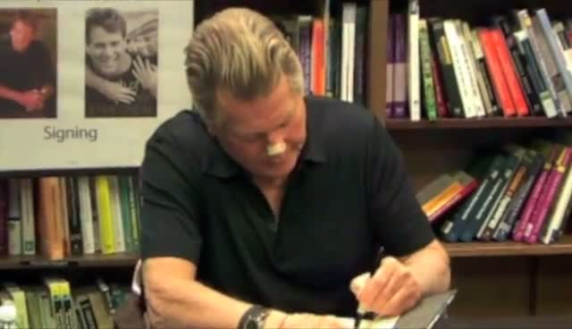 Ryan O'neal Sports Unexplained Plaster At The Signing Of His New Book 'Both Of Us'