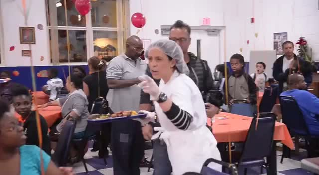 Chris Bosh Helps Out In A Local Kitchen To Feed The Nearby Families