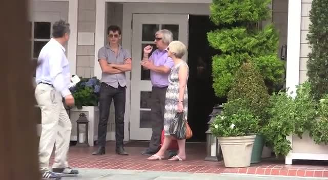 Alex Turner From Arctic Monkeys And His Parents Wait In The Sun To Be Picked Up In A Car