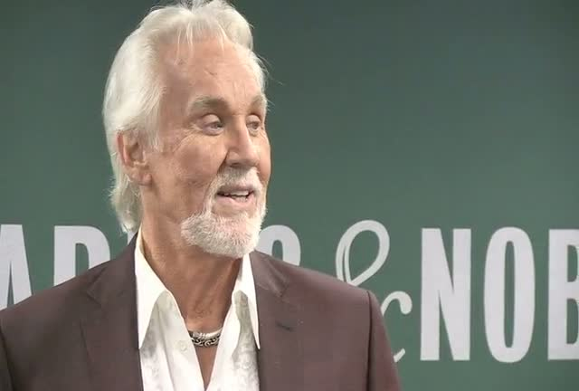 Kenny Rogers Seems Mildly Taken Aback By Photographers At Book Promotion