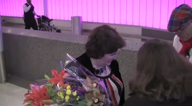 Susan Boyle Greets Fans And Photographers On Arriving At LAX