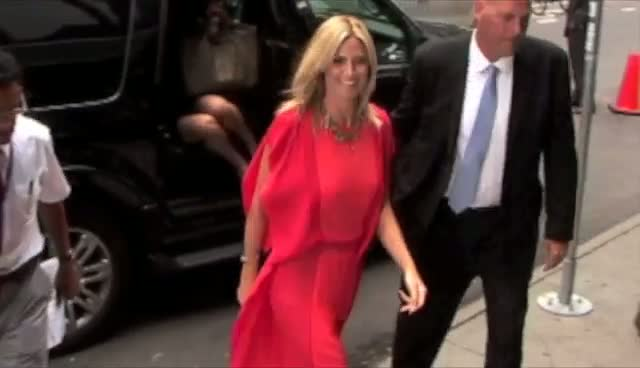 Heidi Klum Looks Stunning In Red On Her Arrival At ABC Studios