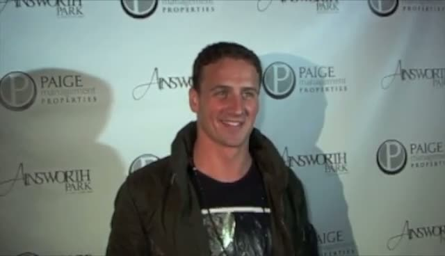 Ryan Lochte Smiles For The Cameras...