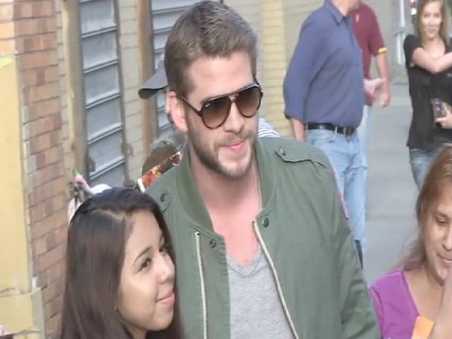 Liam Hemsworth Stops For Endless Photos With Fans Outside 'The Daily Show'