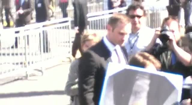 Daniel Radcliffe Tries To Sign For Every One Of His Fans On Arriving At The 2013 Independent Spirit Awards