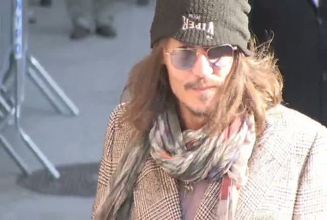 Johnny Depp Almost Loses His Hat Outside The David Letterman Show Studios