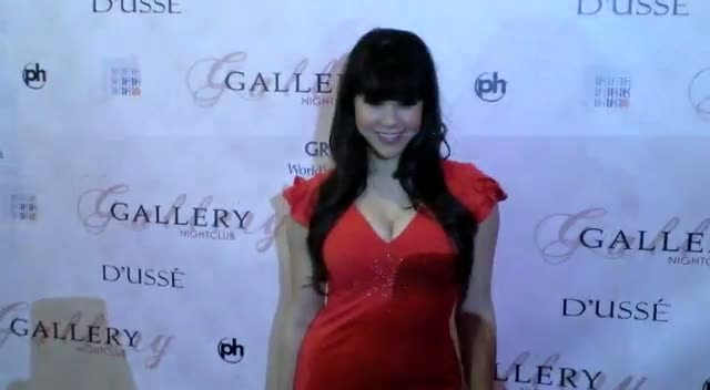 Claire Sinclair Wears Favorite Red 70's Dress To 'Parker' Premiere