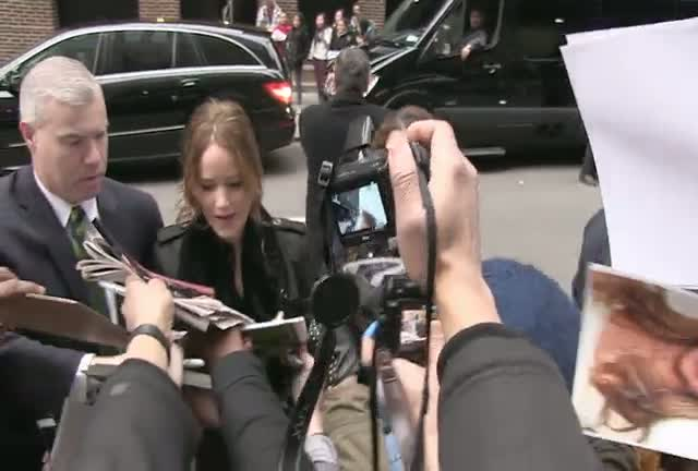 Jennifer Lawrence Greets Adoring Fans Outside 'David Letterman'
