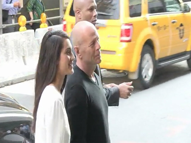 Helen Mirren, Bruce Willis And Catherine Zeta-Jones Sign Autographs At The 'Red 2' Premiere