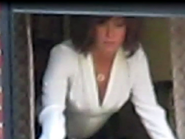 Jennifer Aniston Waves From A Window Filming 'Squirrels to the Nuts'