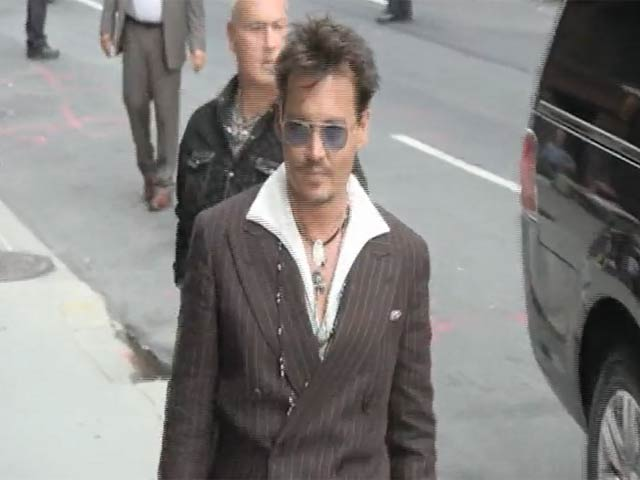 Johnny Depp Shakes Hands With Radioman On Arriving For 'Letterman'