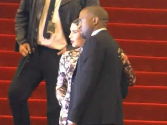 Kim Kardashian Wears Floral As She And Kanye West Arrive At The 2013 Met Gala