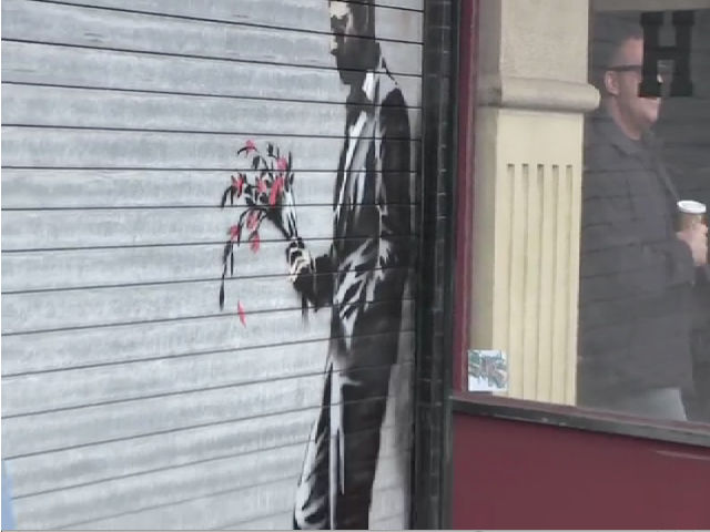Banksy Unveils Leaning Man Artwork At The Hustler Club Entrance