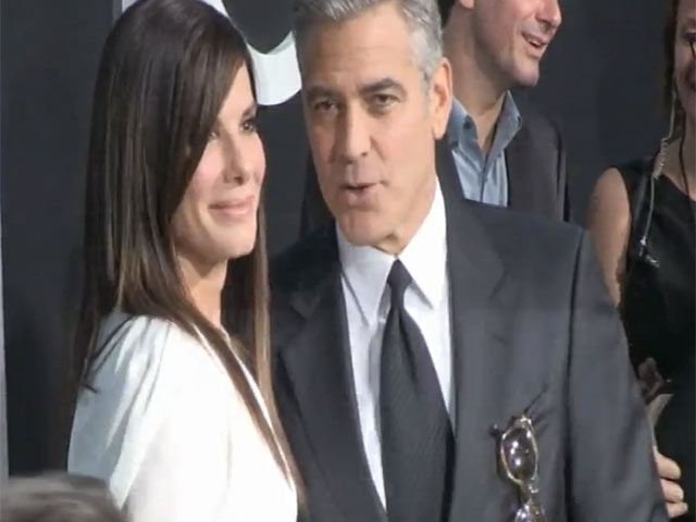 George Clooney And Sandra Bullock Greet Each Other At 'Gravity' NY Premiere