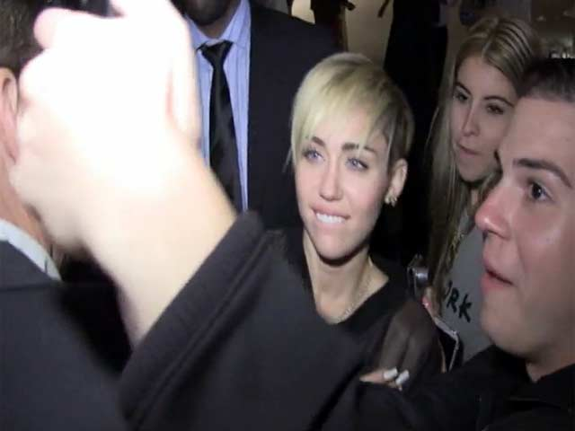 Miley Cyrus Has Photos With Fans At The SNL Afterparty
