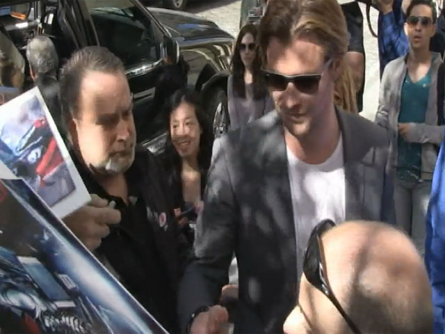Chris Hemsworth Greets Fans Outside The Apple Store In NY