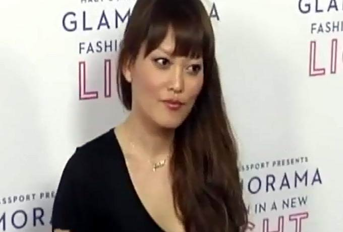 Hana Mae Lee Flashes A Peace Sign On The Red Carpet Of Macy's Passport 'Glamorama' - Part 4