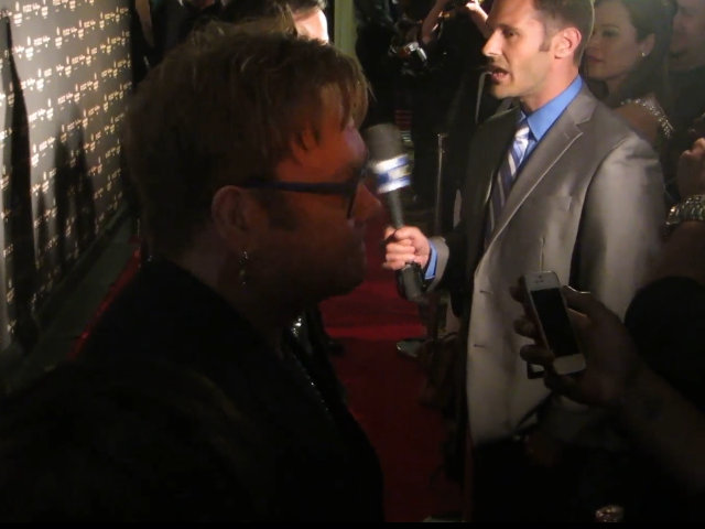Elton John Talks To Reporters On The Red Carpet During Birthday Bash In Vegas