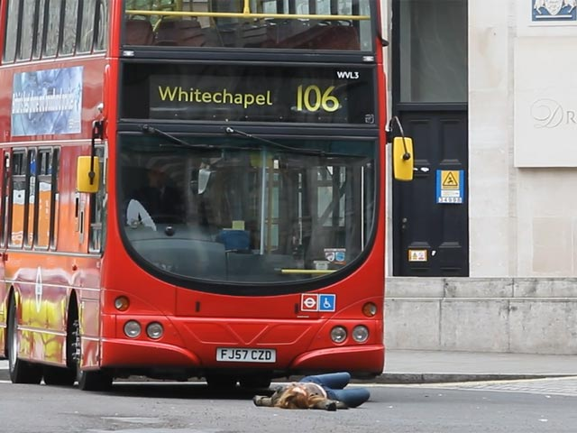 Emily Berrington Lies In Front Of A London Bus On Film Set Of '24: Live Another Day - Part 3