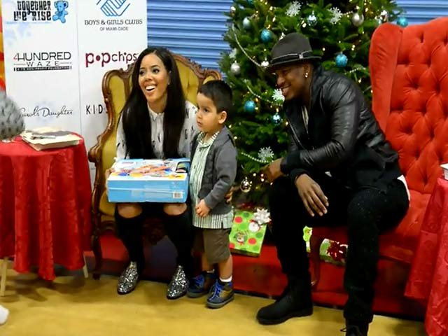 Ne-Yo And Angela Simmons Greet One Of Their Youngest Fans During Miami Charity Visit  - Part 2
